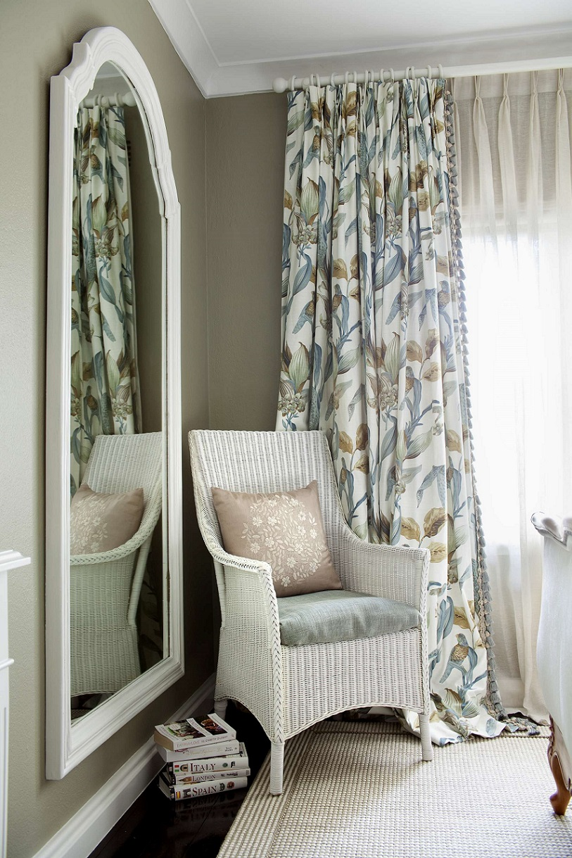 Room with curtains and chair
