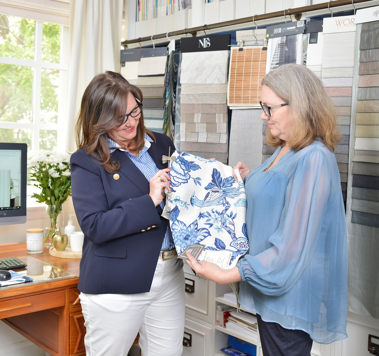 Nadine with clients choosing fabric