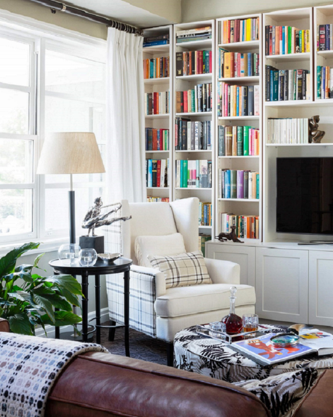 classic interior design library bookshelves white wingback chair lamp side table canberra