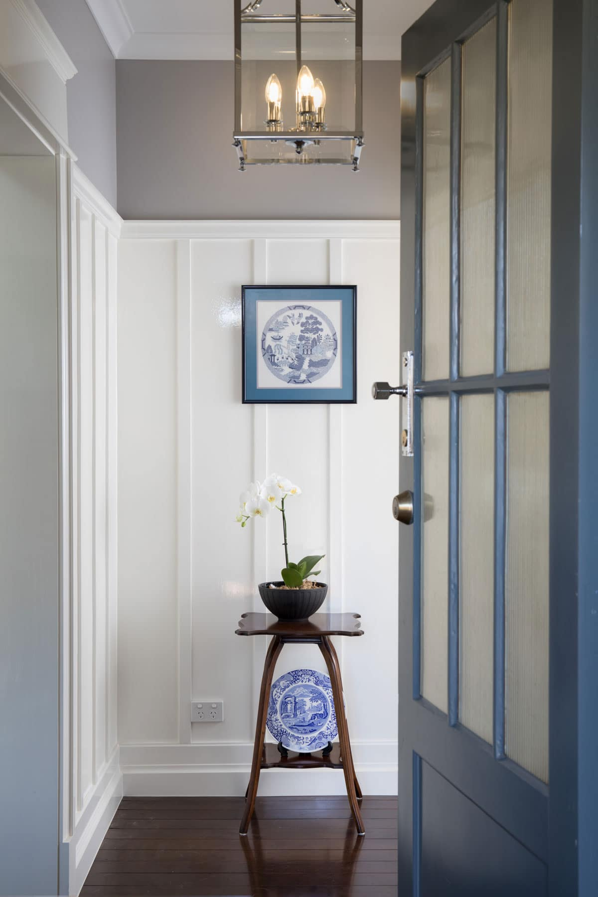 traditional design classic entryway hamptons blue door white wainscoting decorating project