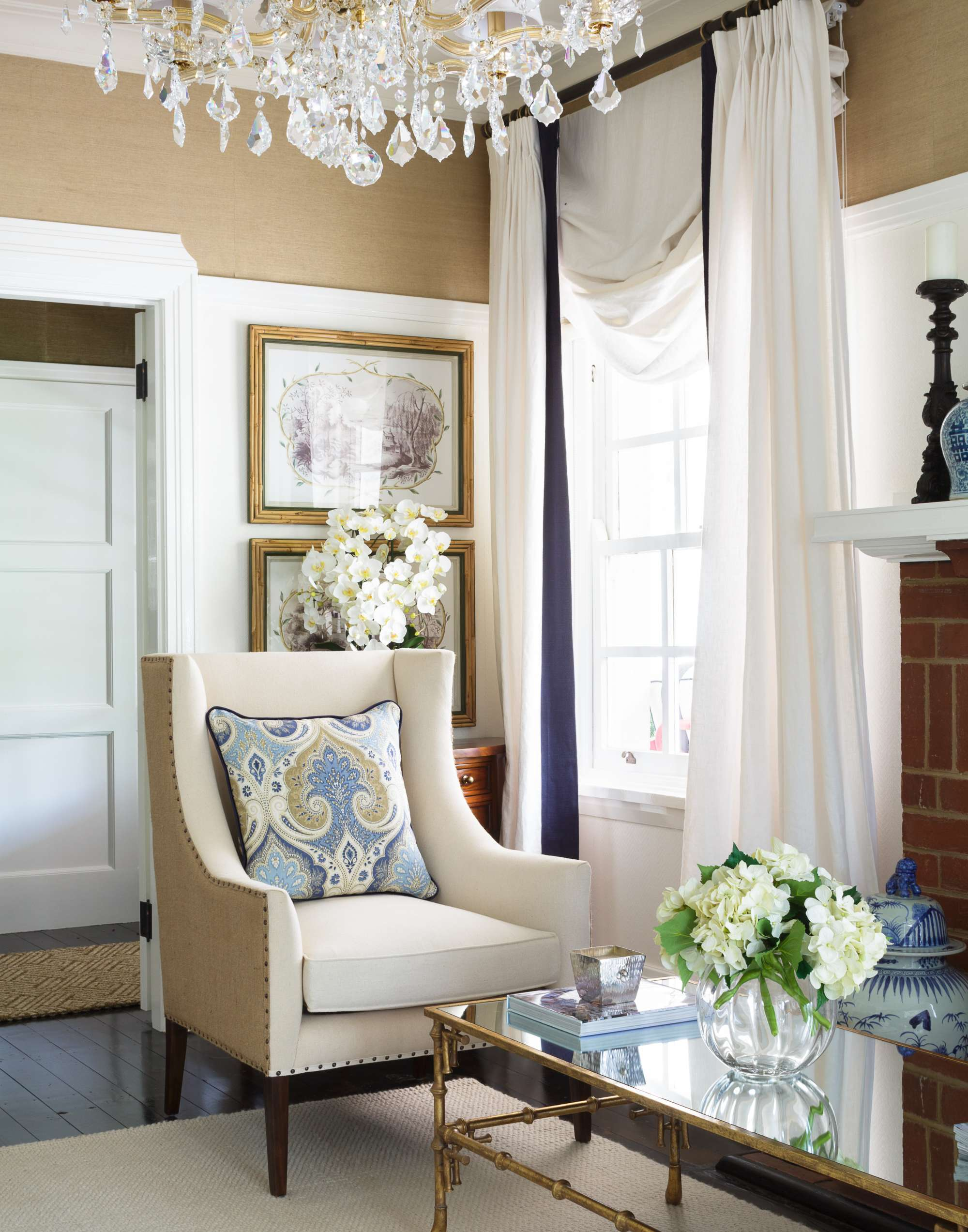canberra hamptons inspired interior design white drapery wingback chair chandelier