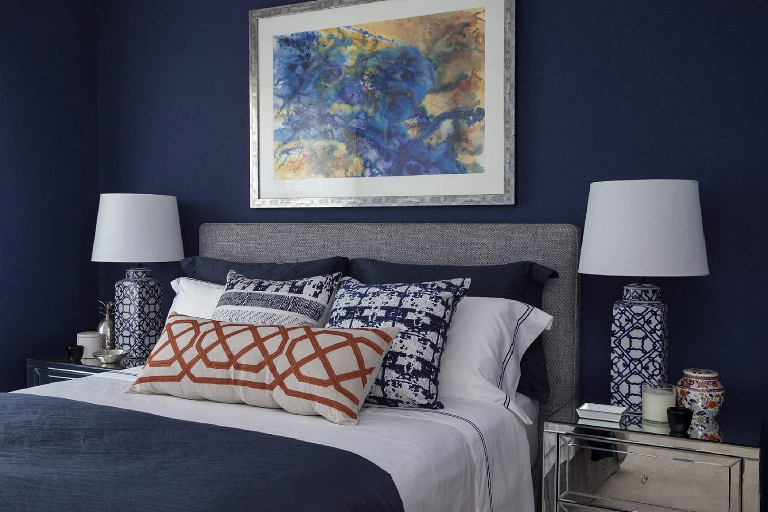 guest bedroom classic orange blue white patterns abstract art