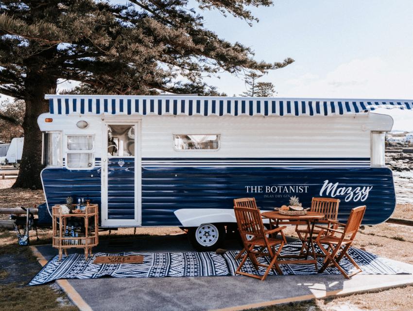 journey-home-interiors-yarralumla-au-interior-design-myths-caravan-red-white-at-beach-for-rent
