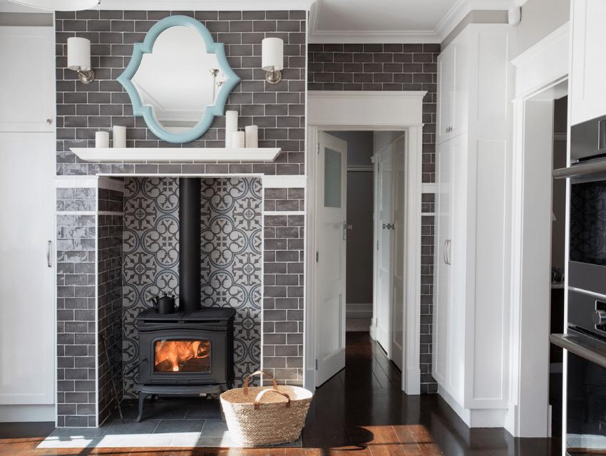 journey-home-interiors-yarralumla-au-interior-design-myths-tiled-fireplace-patterned-grey-tile-brushed-nickel-sconses