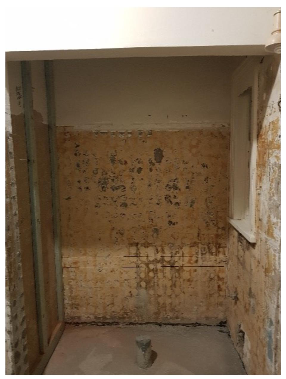 journey-home-interiors-forrest-demolition-1930s-bathroom-remodel-consturction-begins-shower-drain-in-progress