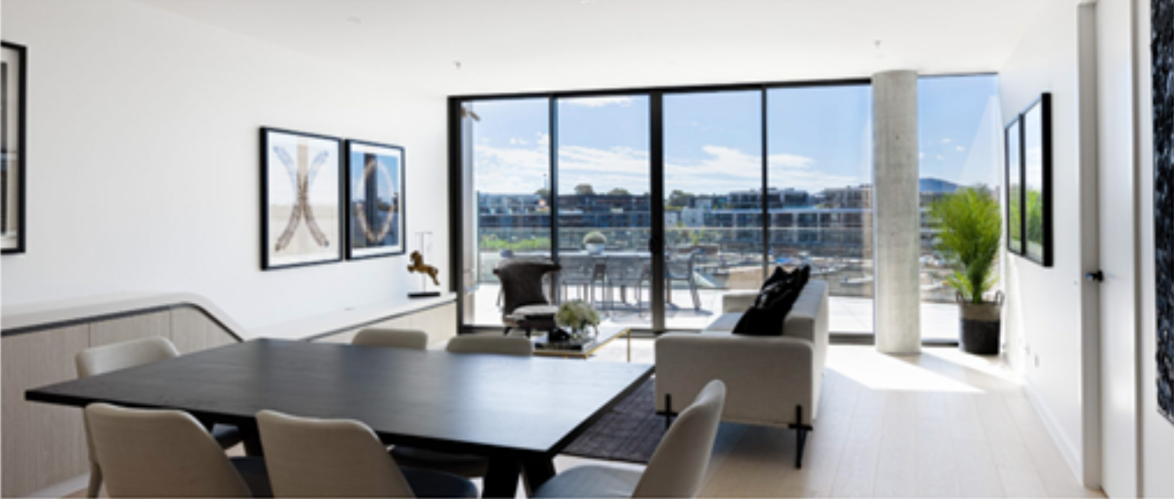 journey-home-interiors-griffith-downsizing-obstacles-open-concept-living-room-dining-room-floor-to-ceiling-windows